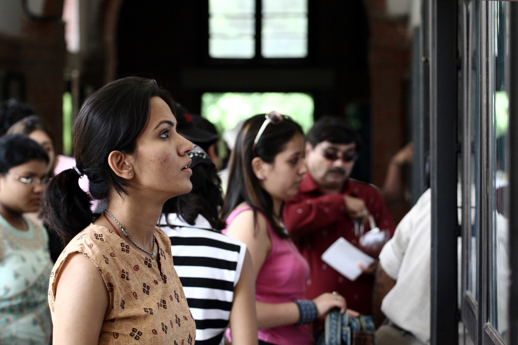 An applicant examines various stream options at a counter for submitting admission forms at St. Stephens College in Delhi University, New Delhi. Photo Reuben singh.